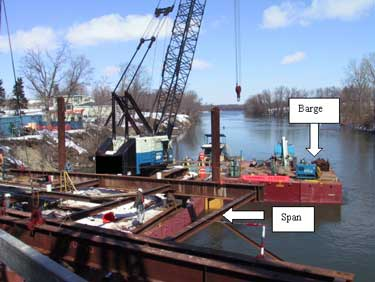 Photo 2. Overview of the barge and workstation where the temporary bridge span was placed and being dismantled.