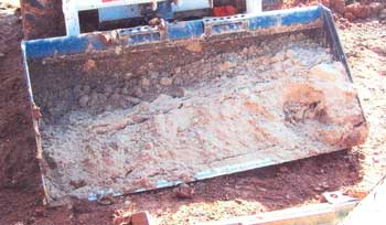 Figure 2. Skid-steer loader bucket of sand.