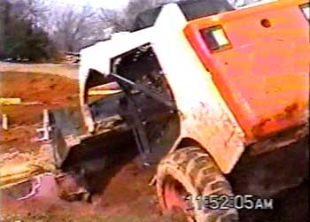 Figure 3. Skid-steer loader tipped forward.