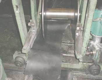Figure 1. Tread liner and take-up spool on the dismantled tread scrap machine involved in the incident.