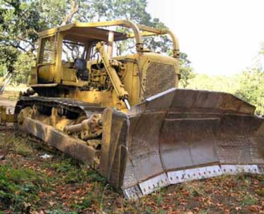 The Caterpillar D8H bulldozer in this incident unexpectedly rolled backward from a parked position.