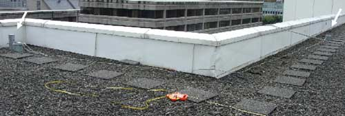 Two certified anchor points are visible here on the roof of the building where the incident occurred.