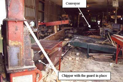 Figure 1. The conveyor transports waste  		  wood to the chipper.