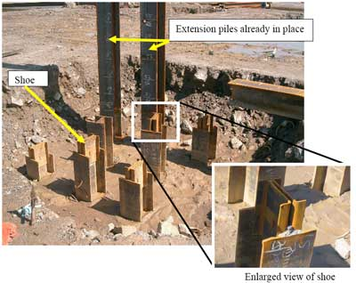 Pit with two extension piles in place and other piles with shoes welded