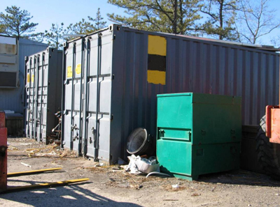 Incident location with similar metal storage containers.