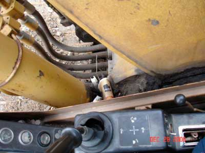 excavator boom, boom control lever, and cab window area