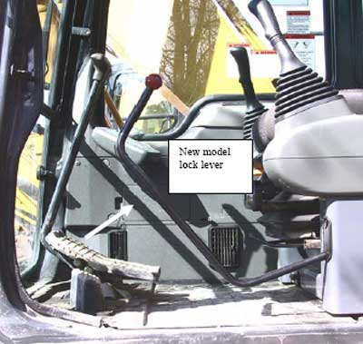 Photo 4. The lock bar in newer model excavators blocks the cab door path when in the unlock position.