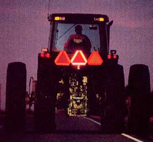 rear of tractor with bright slow moving vehicle (SMV) emblems