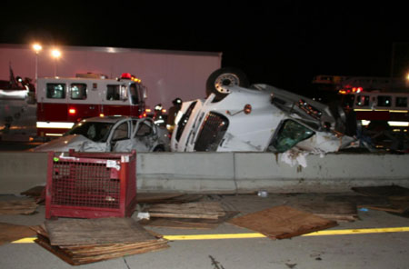 Photograph of semi and car involved in fatal crash.