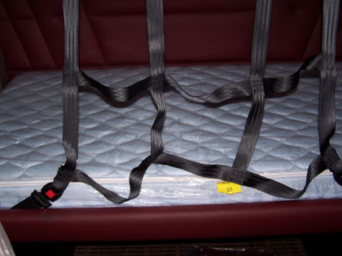 Photograph of a restraint system in a similar sleeper berth.