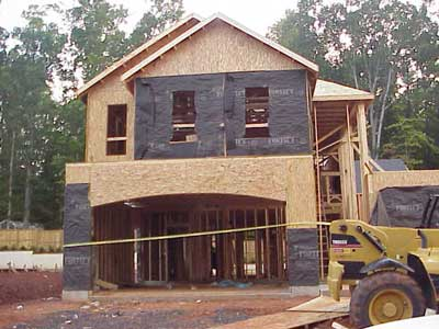 Two-story home that workers were framing.
