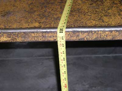 tape measure showing 24 inches from chute to ground