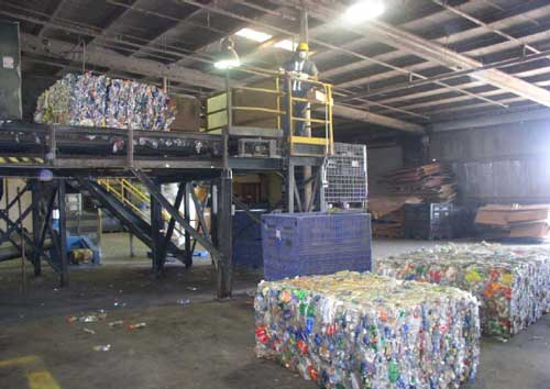 bales of plastic bottles and bale breaker machine