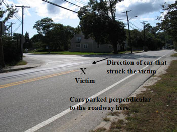 The intersection where the incident occurred. The state highway is the roadway with the solid double yellow lines.