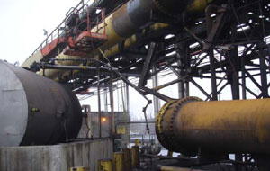 Figure 1. Incident Scene. 54-inch pipeline blown apart, area where patch repair occurred, and man lift used to elevate workers to pipeline repair area.