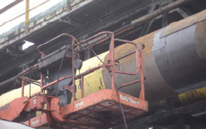 Figure 5. Gasketed steel cladding patches and man lift.