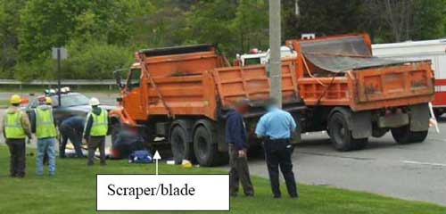 Arrow pointing to scraper/blade on one of the trucks