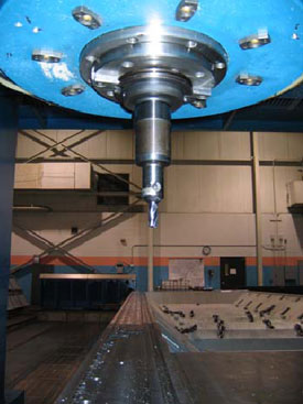 Figure 1. Cutting head of vertical gantry mill and part being machined.