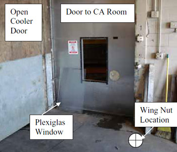 Figure 1. Outer door, inner aluminum door, Plexiglas window, opening to CA room, warning sign, wing nuts location.
