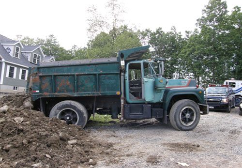 The dump truck that crushed the victim at the residential construction site.