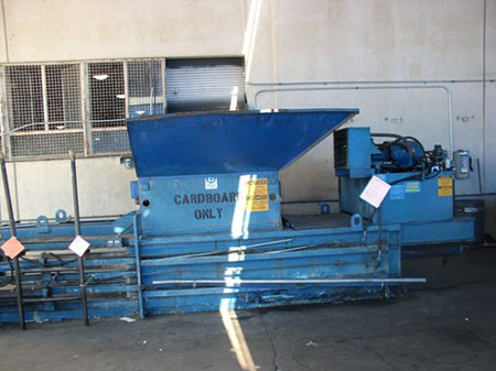 The cardboard baler machine involved in the incident.