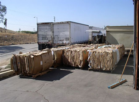 The bales of recycled cardboard produced by the machine involved in the incident.