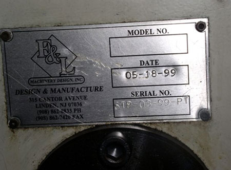 A picture of the name plate affixed to the machine.