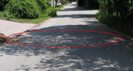 Location of the incident. Roadway depression is circled in red.