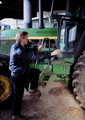 "photo shows person maintaining ""three point contact"" while climbing on the tractor steps"
