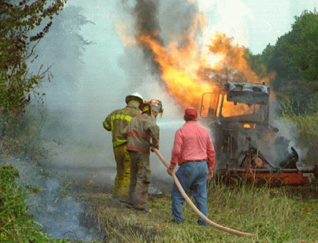 photo of firefighting personnel extinguishing the flames from the explosion