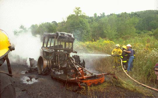 photo of tractor and surrounding burnt ground