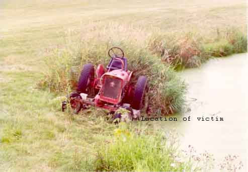 photo of the tractor near the water