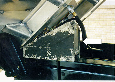 photo shows metal wedge-shaped alternative after-market body prop in place under truck body