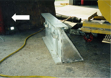 photo shows wide metal alternative after-market body prop laying on floor