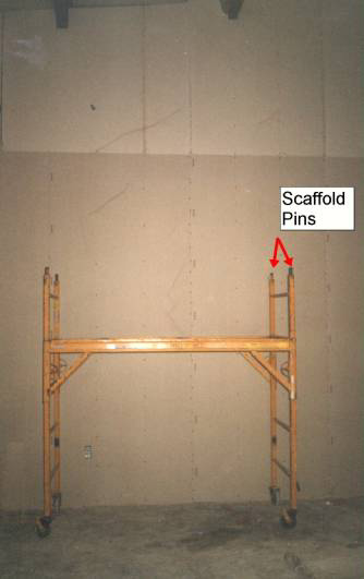 scaffold  position at the time of the fall -- arrows point to scaffold pins