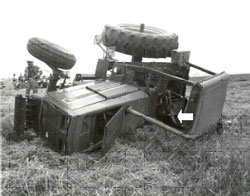 overturned tractor -- arrow indicates the victim's location