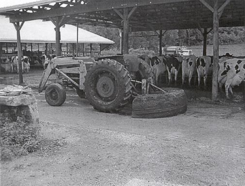 view of tractor with fabricated manure scraper