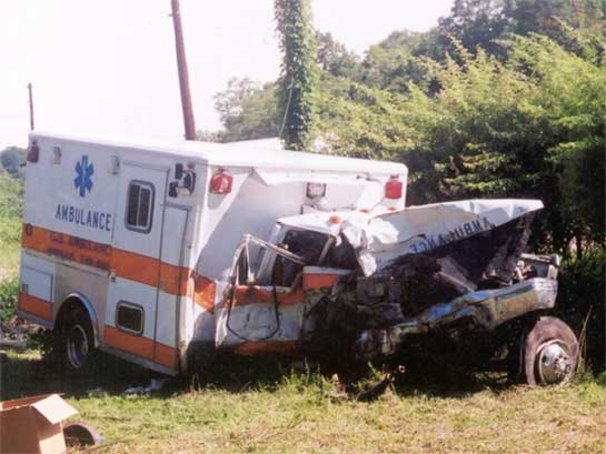 Type I ambulance at employer's vehicle yard after recovery from crash site