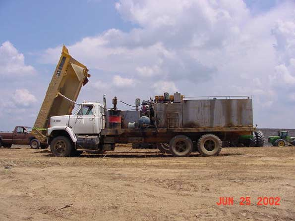 Placement of the service truck and dump truck that the victim was servicing at the time of the incident.