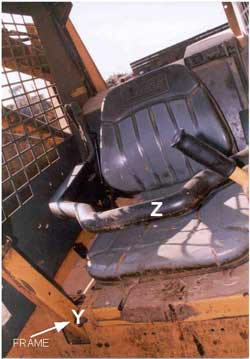 Skid steer loader. Frame where the head injury occurred. Also shows seat bar.
