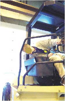 Seat belted operator on a compactor similar to that involved in the incident.