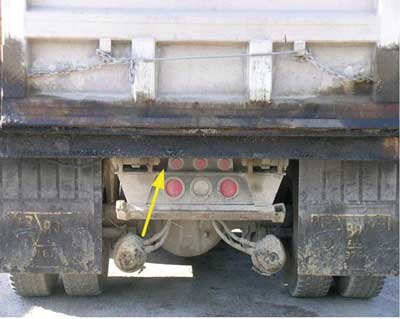 View of the rear of the truck.  The reverse signal alarm is mounted behind the frame.