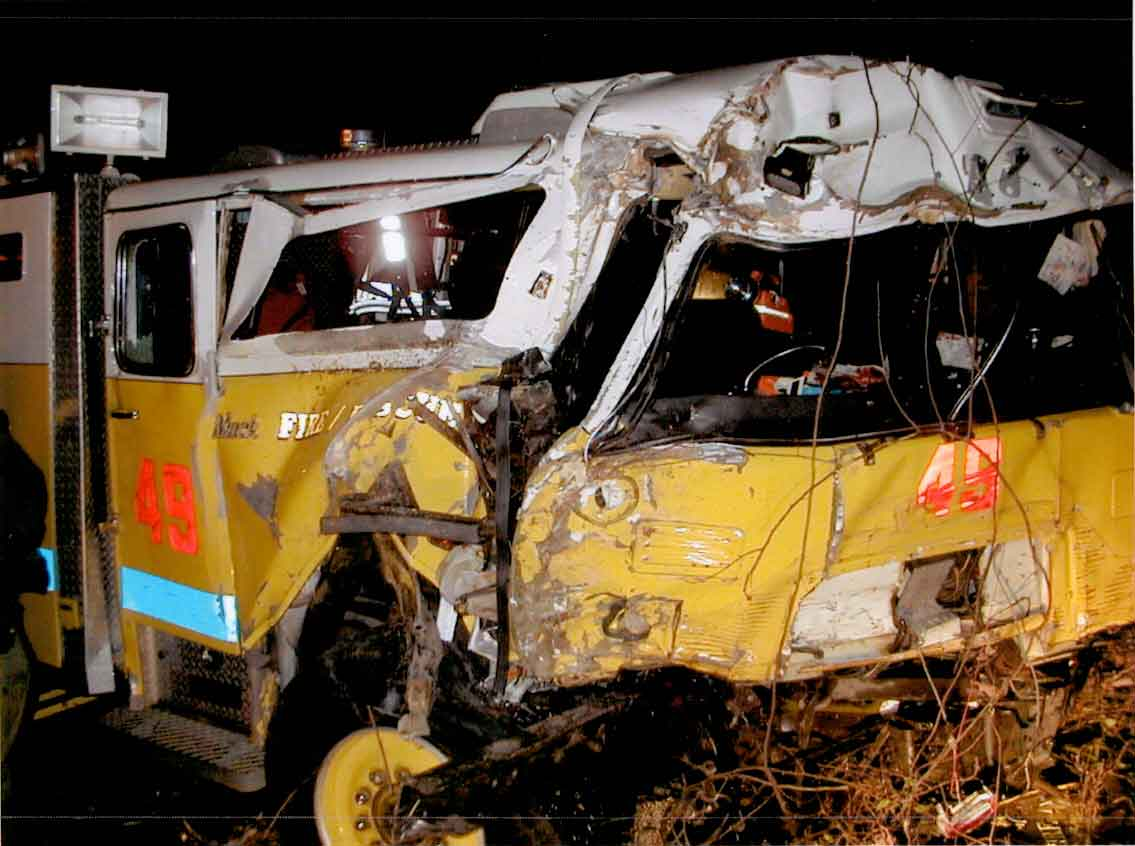 Front page photo.  Photograph of the rescue truck involved in this incident.  Photograph was taken of the front view of the recovered truck.