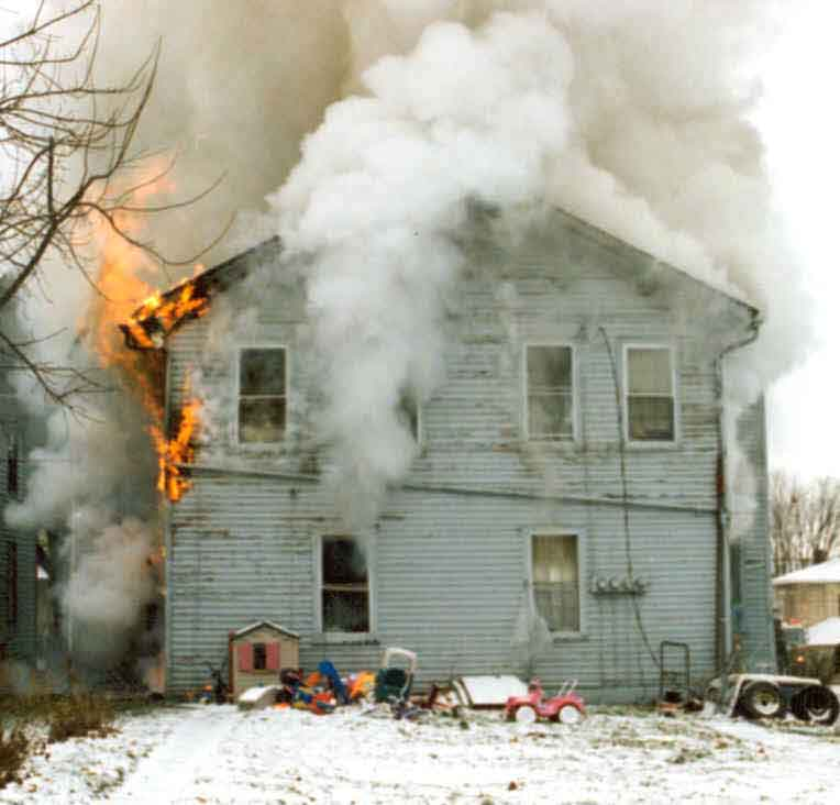 Front Page Photo: Photograph of the rear of the burning structure.