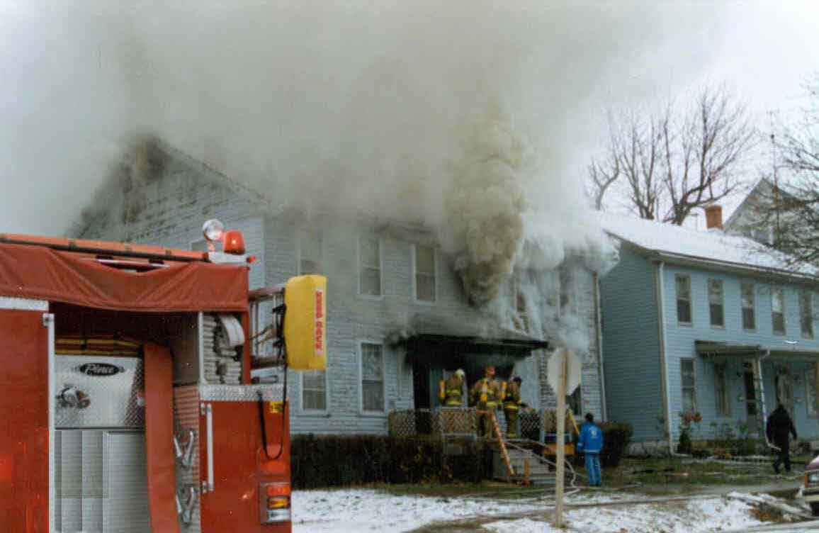Photo 1.  Photograph of the front of the burning structure showing the entrance which the fire fighters entered.