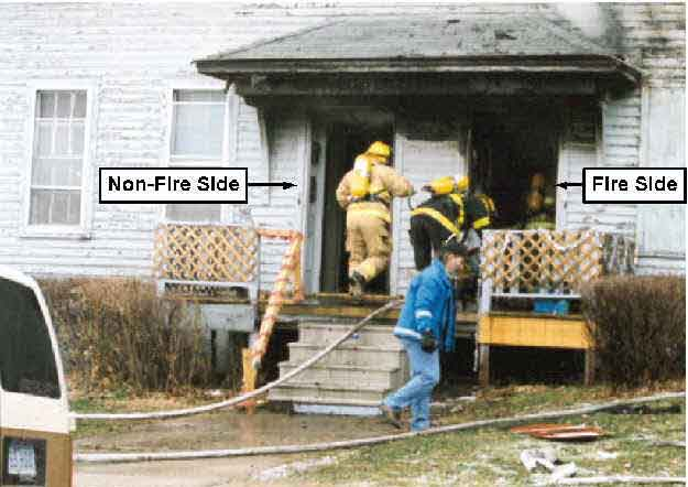 Photo 2.  Photograph of the front of the structure, depicting the non-fire side and the fire side of the structure.