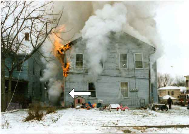 Photo 3.  Photograph of the rear of the burning structure, depicting the approximate origin of the fire.