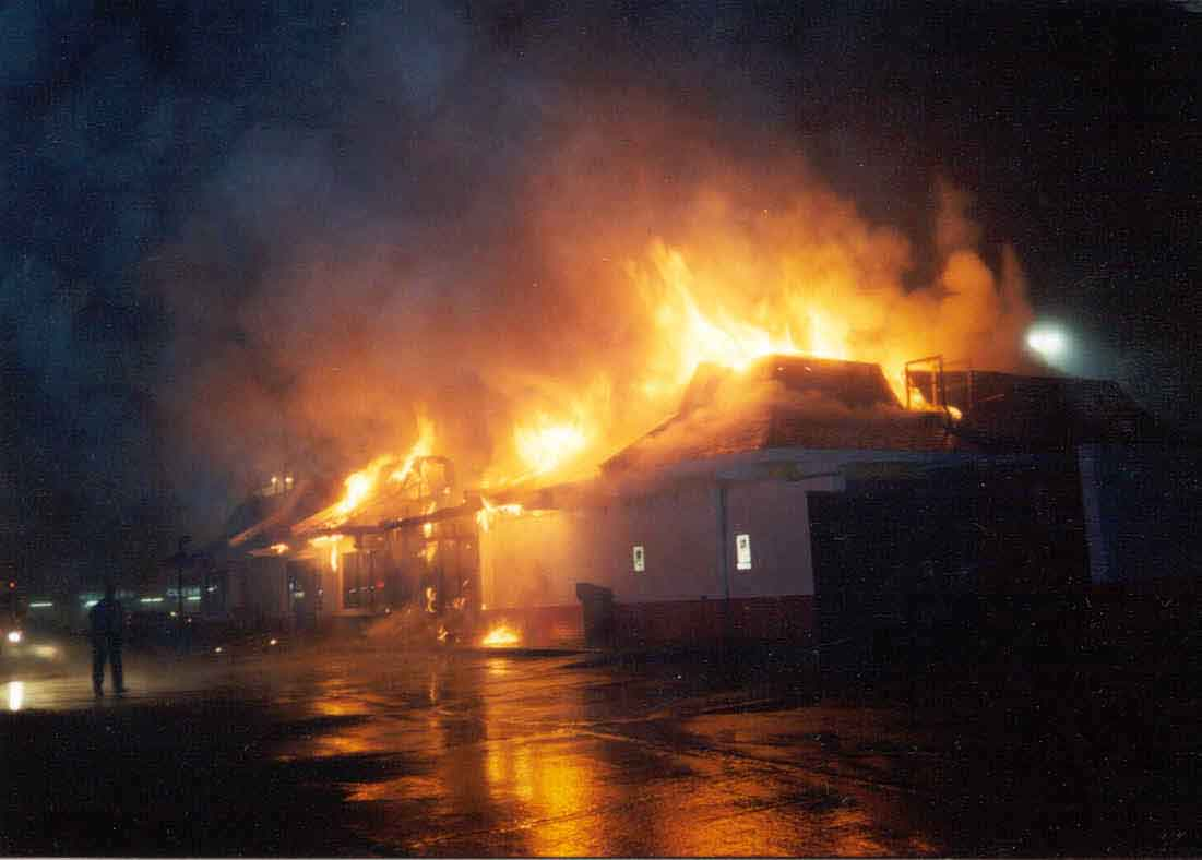 Front page photo:     Photograph of the restaurant involved in this incident, fully engulfed in flames.