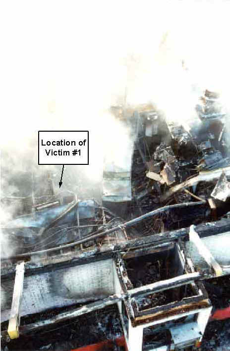 Photo 11: Post-fire, aerial view of the restaurant, showing the location of Victim #1.
