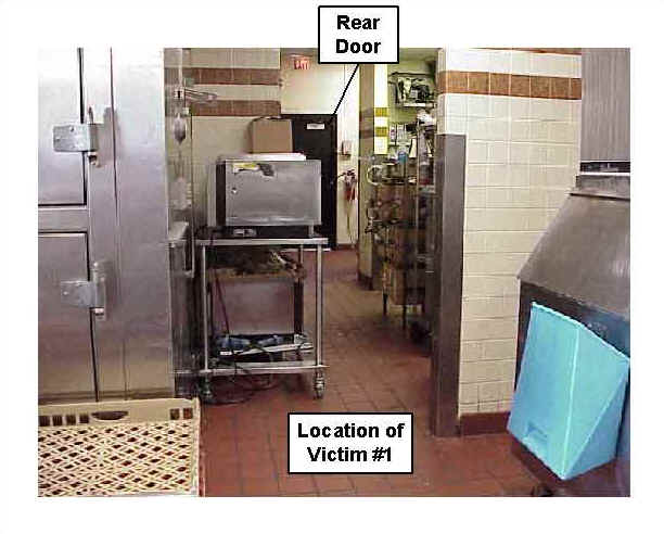 Photo 12: Pre-fire, interior view of the kitchen area of similar restaurant, showing the location of Victim #1.